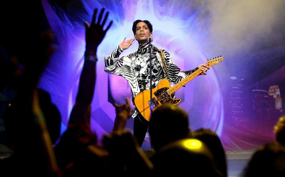 Prince, shown in a 2009 Los Angeles performance, died at age 57 after being found unresponsive at his compound in Minnesota on Thursday. Photo: Kristian Dowling