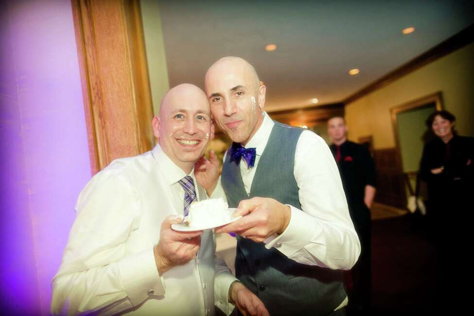 Robert LaRocca and Christopher Rambo share cake during their October 12, 2014 nuptials. (Jeff Foley Photography)