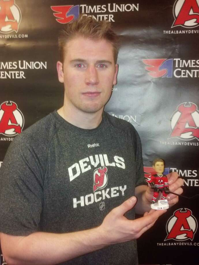 Dan Kelly of the Albany Devils displays a bobblehead featuring his likeness, which will be given away at their game against St. John's on Saturday night at Times Union Center. (Pete Dougherty / Times Union) ORG XMIT: MER2015012818252488
