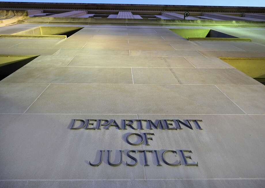 FILE - In this May 14, 2013, file photo, the Department of Justice headquarters building in Washington is photographed early in the morning. The Justice Department has signaled that it won't try to block a lawsuit arising from the CIA's harsh interrogation techniques, leaving the door open for a court challenge over tactics that have since been discontinued and widely discredited. (AP Photo/J. David Ake, File) Photo: J. David Ake, Associated Press