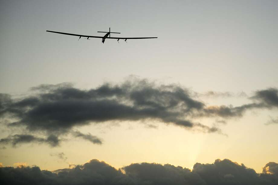 The Solar Impulse 2 solar plane flies out of Kapolei, Hawaii. It will take two-and-a-half days to reach Mountain View. Photo: Marco Garcia, Associated Press