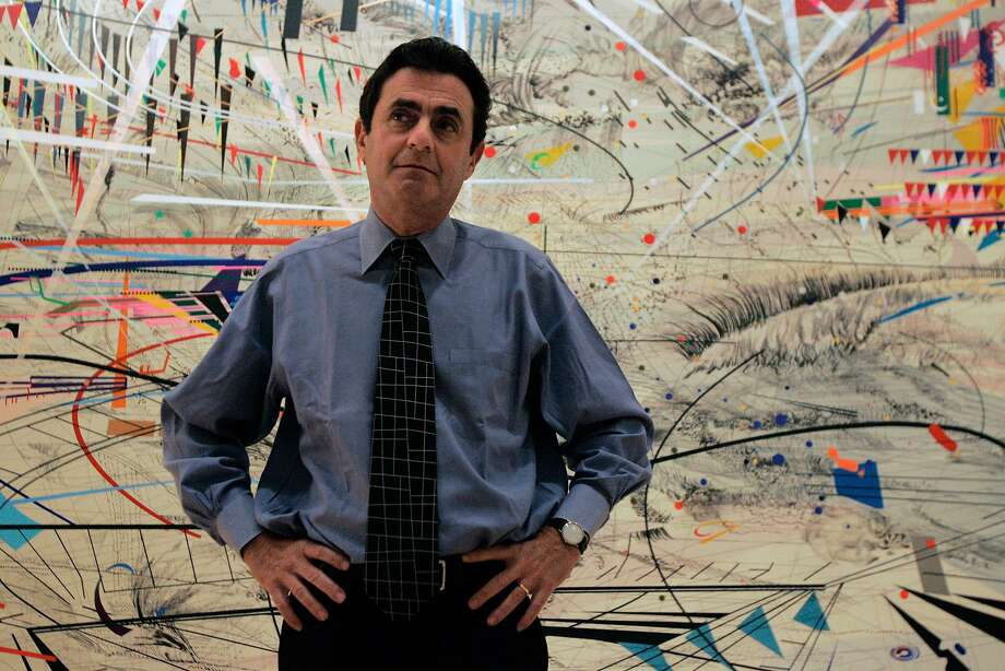 "Neal Benezra, Director of the San Francisco Museum of Modern Art, photographed in front of ""Stadia I"" by Julie Mehretu at the museum. Photo: Laura Morton, Special To The Chronicle"