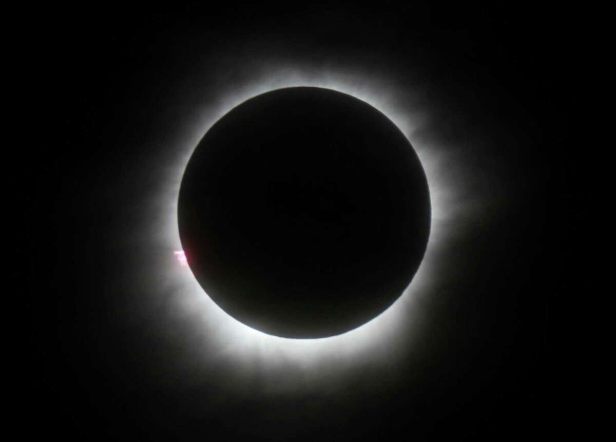 FILE - This March 9, 2016 file photo shows a total solar eclipse in Belitung, Indonesia. Hotel rooms already are going fast in Wyoming and other states along the path of next year?'s solar eclipse. The total solar eclipse on Aug. 21, 2017, will be the first in the mainland U.S. in almost four decades. (AP Photo, File) ORG XMIT: LA501