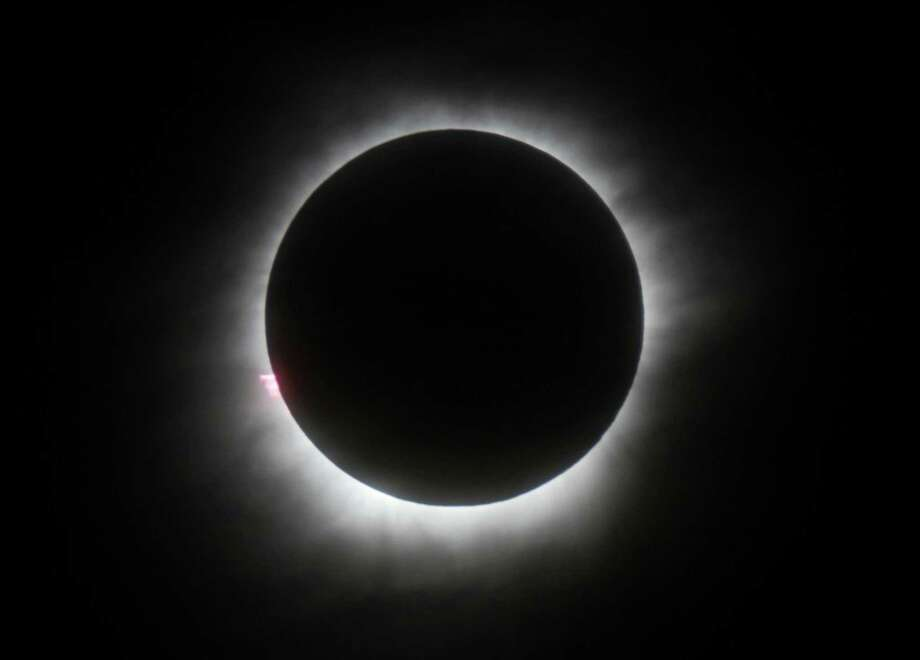 FILE - This March 9, 2016 file photo shows a total solar eclipse in Belitung, Indonesia. Hotel rooms already are going fast in Wyoming and other states along the path of next year's solar eclipse. The total solar eclipse on Aug. 21, 2017, will be the first in the mainland U.S. in almost four decades.   (AP Photo, File) ORG XMIT: LA501 / Copyright 2016 The Associated Press. All rights reserved. This m
