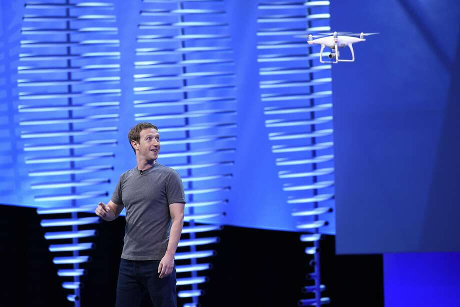 Facebook CEO Mark Zuckerberg views a drone flying as he speaks at the Facebook F8 Developers Conference this month. Some drone footage appeared on Facebook Live. Photo: Michael Short, Bloomberg