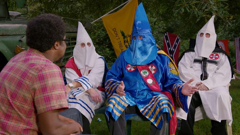 W. Kamau Bell makes earnest conversation about attitudes toward race with Ku Klux Klan members in Arkansas. Photo: STAFF, Credit: CNN