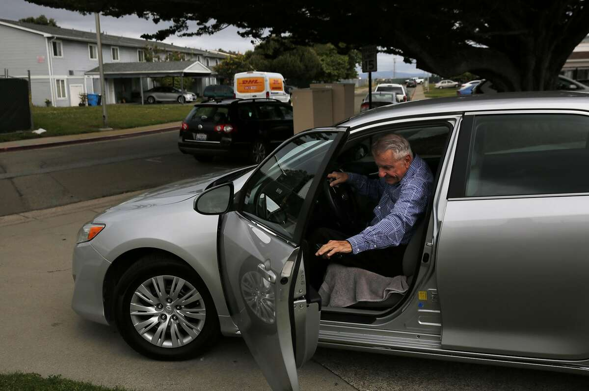 Dennis Coder, 75, demonstrates how he leaves for work to drive for Uber from his home on Treasure Island April 21, 2016 in San Francisco, Calif.