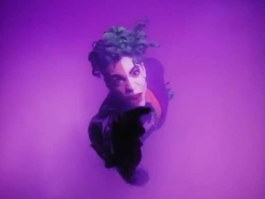 "The artist Prince appears as a combination of Batman villains The Joker and Harvey ""Two Face"" Dent in the music video to his quirky 1989 hit song ""Batdance,"" which was featured in the Michael Keaton-led ""Batman"" film. Photo: Warner Bros."