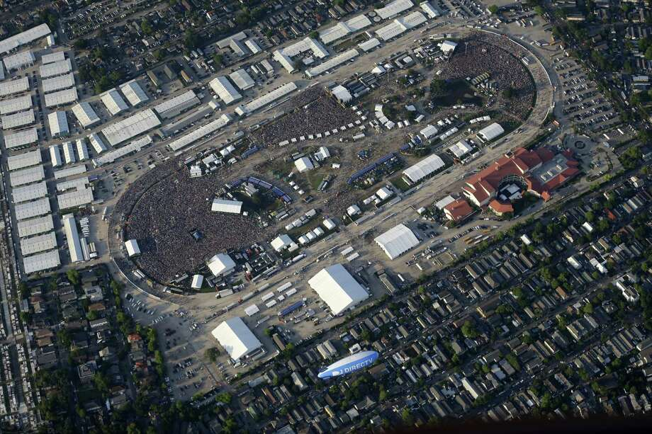 FILE - In this May 2, 2015 aerial file photo, In this photo, crowds are seen as Elton John performs at the Acura Stage, left, Ed Sheeran performs at the Gentilly Stage, right, and T.I. performs simultaneously at the Congo Square Stage, top center, at the New Orleans Jazz and Heritage Festival in New Orleans. The 47th annual festival features top artists covering many genres of music from jazz to rock to Zydeco to rap to pop to R&B and gospel. The gates to the Fair Grounds Race Track, where the festival is held, open at 11 a.m. The music on 11 stages starts shortly thereafter. (AP Photo/Gerald Herbert, File) ORG XMIT: LAGH205 Photo: Gerald Herbert / Copyright 2016 The Associated Press. All rights reserved. This m