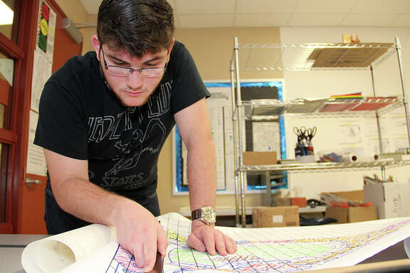 Turner College and Career High School Project Lead The Way engineering student Ryan Hashem works on an animal adoption shelter design for the Michael G. Meyers 2016 Design Competition.
