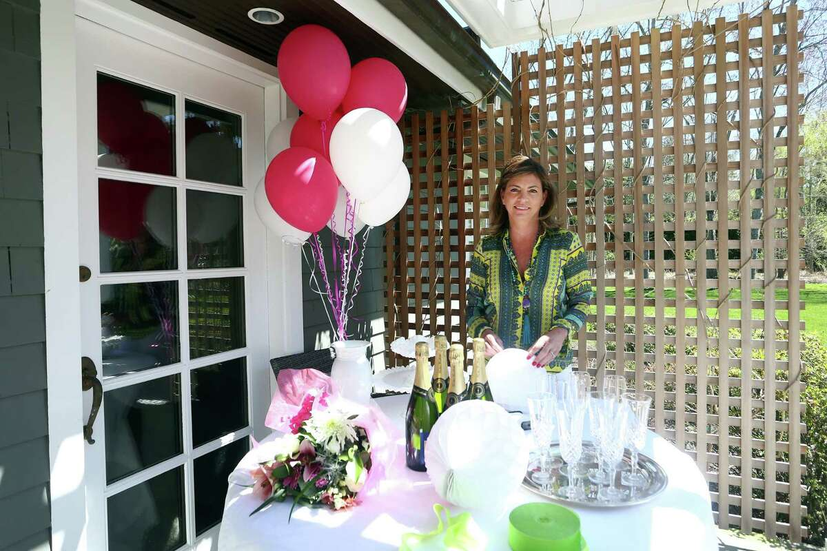 Madalene Benoist d'Etiveaud, an event planner living in Darien, poses for a photo at her home on Wednesday, April 20, 2016.