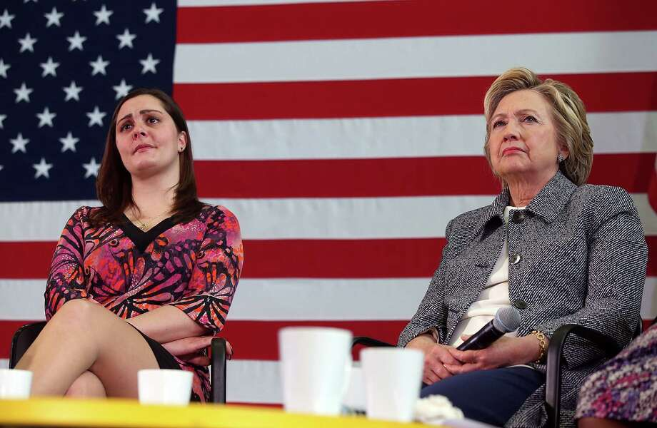 Democratic presidential candidate former Secretary of State Hillary Clinton (R) and Erica Smegielski look on during the Hartford Gun Violence Prevention Discussion on April 21, 2016 in Hartford, Connecticut. Hillary Clinton held a panel discussion with families of victims of gun violence as she campaigned in Connecticut ahead of Tuesday's presidential primary. Photo: Justin Sullivan / Getty Images / 2016 Getty Images