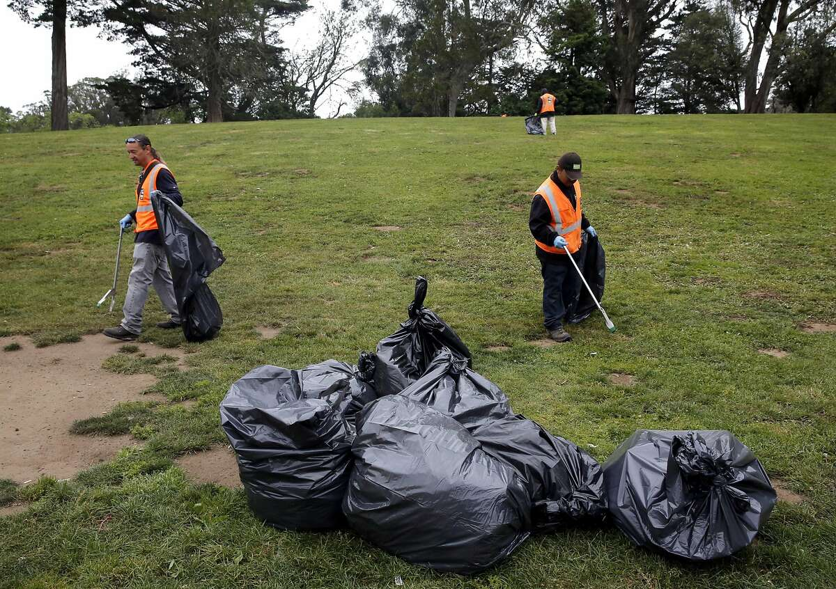 San Francisco Recreation and Park employees clean up after the 4/20 celebration in Golden Gate Park in San Francisco, California, on Thursday, April 21, 2016.