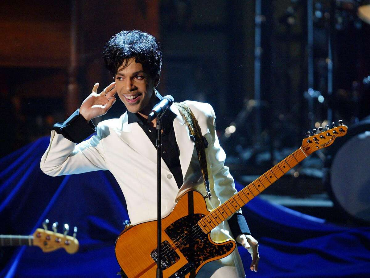 Prince performs at the 19th annual Rock and Roll Hall of Fame induction ceremony, Monday, March 15, 2004, at the Waldorf Astoria Hotel in New York.