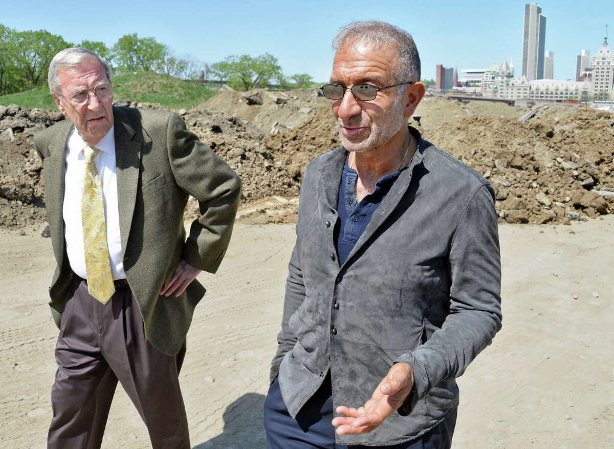 Rensselaer Mayor Daniel Dwyer, left, and SUNY Polytechnic Institute President and CEO Alain Kaloyeros lead a tour of the vacant waterfront lot where the Rensselaer High School once stood Thursday May 7, 2015 in Rensselaer, NY. (John Carl D'Annibale / Times Union)