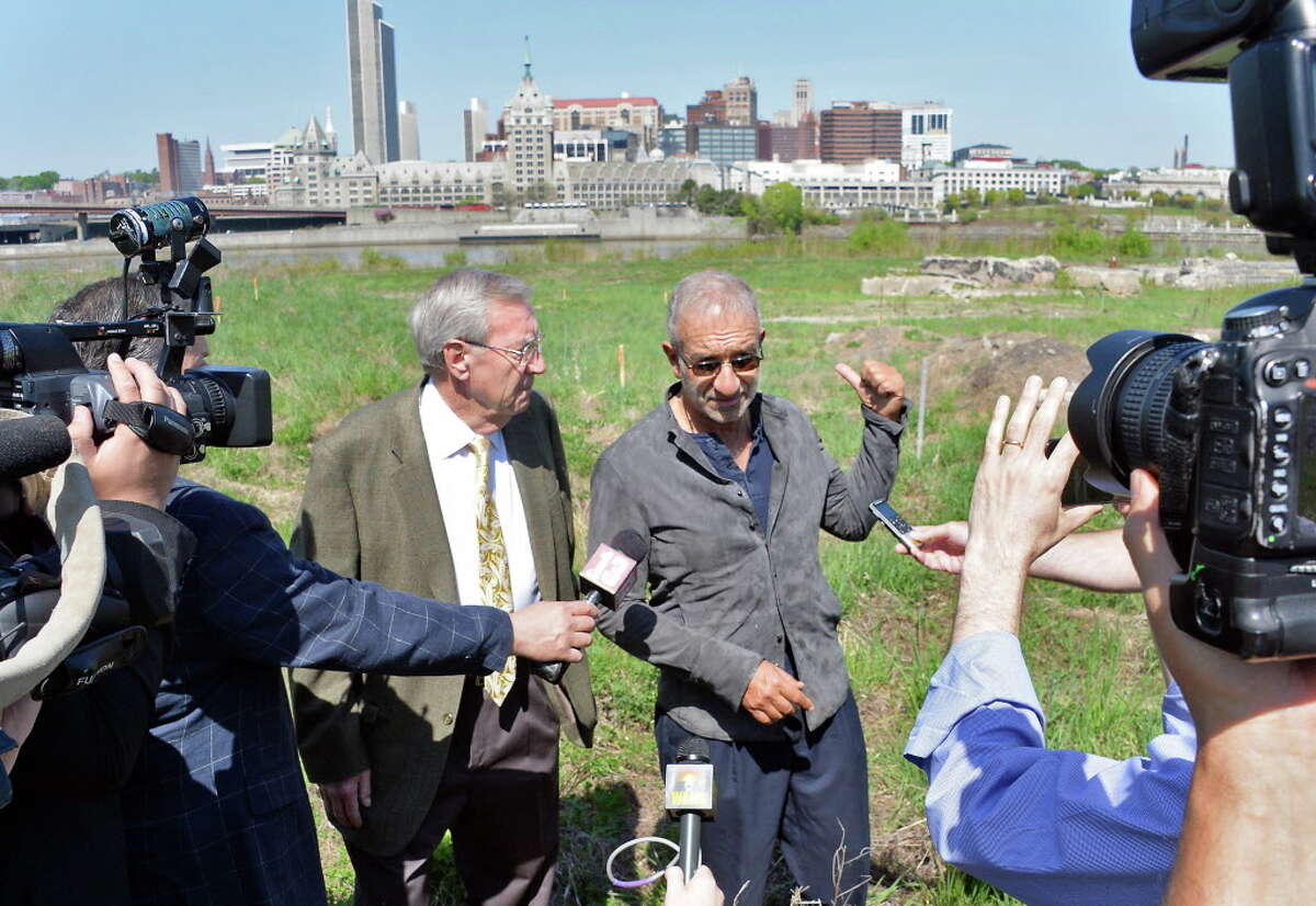 Rensselaer Mayor Daniel Dwyer, left, and SUNY Polytechnic Institute President and CEO Alain Kaloyeros speak with reporters at the vacant waterfront site where the Rensselaer High School once stood Thursday May 7, 2015 in Rensselaer, NY. (John Carl D'Annibale / Times Union)
