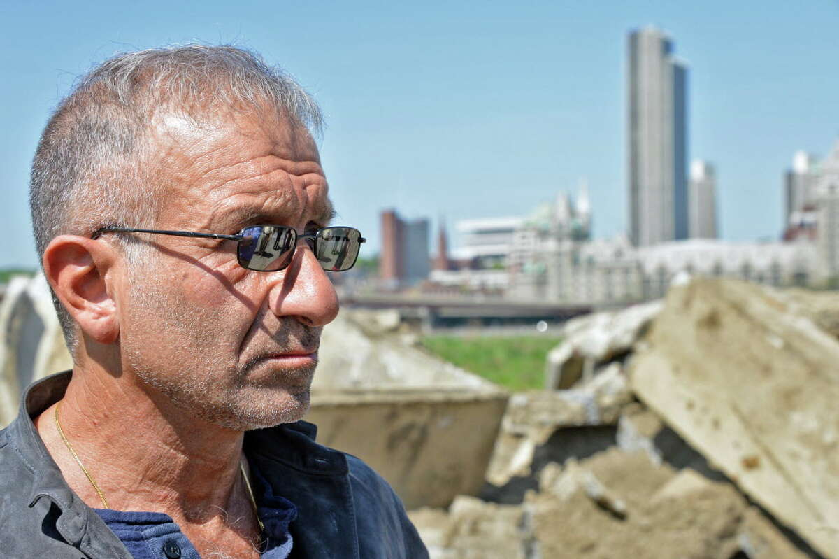 SUNY Polytechnic Institute President and CEO Alain Kaloyeros during a tour of the vacant waterfront lot where the Rensselaer High School once stood Thursday May 7, 2015 in Rensselaer, NY. (John Carl D'Annibale / Times Union)