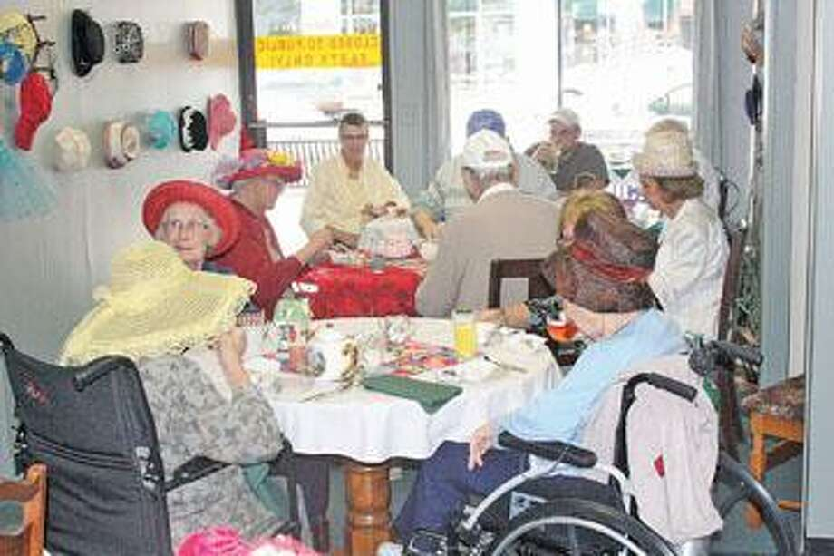 Patrons enjoy tea in The Tea Room at Coffee Cup Plus in downtown Bad Axe.