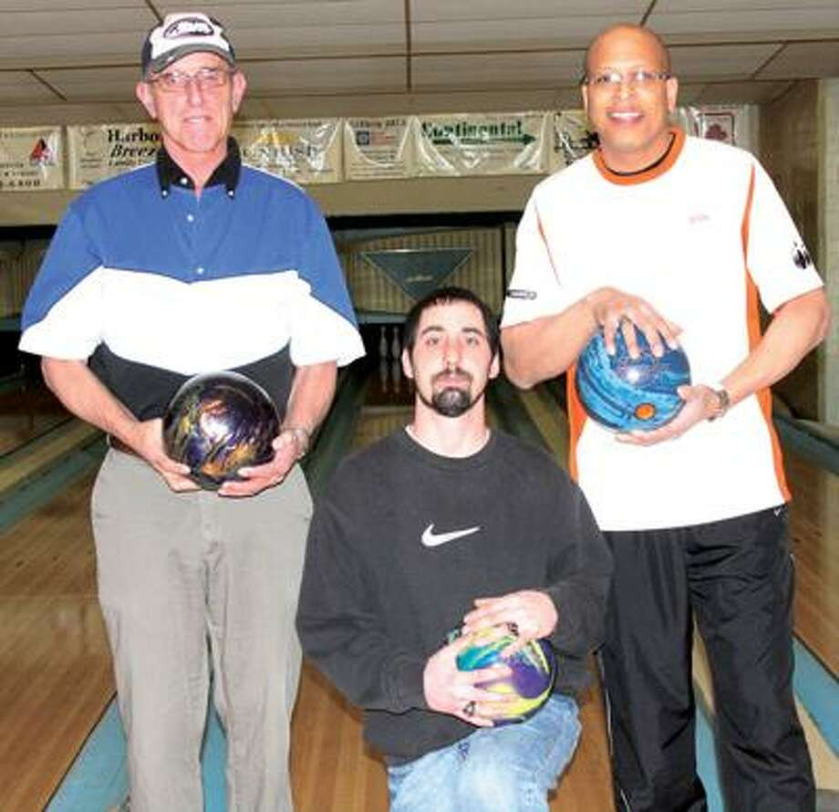 From left to right, Jim Gerstenschlager, Justin Gerstenschlager and Willie Hale pose at Blue Water Lanes in Harbor Beach after some impressive accomplishments. Jim Gerstenschlager rolled a 300 game, Justin Gerstenschlager turned in an 825 series while Hale had an 807 series. For more sports photos, go to www.michigansthumb.com, staff photos and click on the sports gallery.
