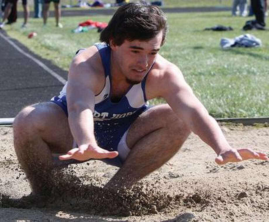 Port Hope's Cody Deer lands in the long jump on Tuesday at the North Huron Track & Field Invitational.