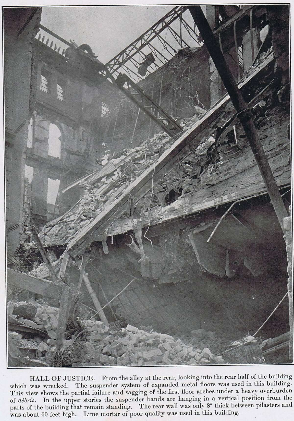Hall of Justice, seen from the rear alley, showing the wrecked rear half of the building. A suspender system of expanding metal floors was used in this building. The overloading of debris caused much of the damage...