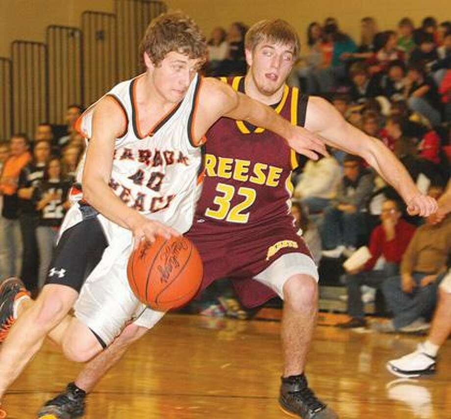 Harbor Beach's Andrew Siemen (40) drives against Reese's Caleb Gnatkowski (32) during the first quarter of the Pirates' 62-54 loss on Wednesday night.