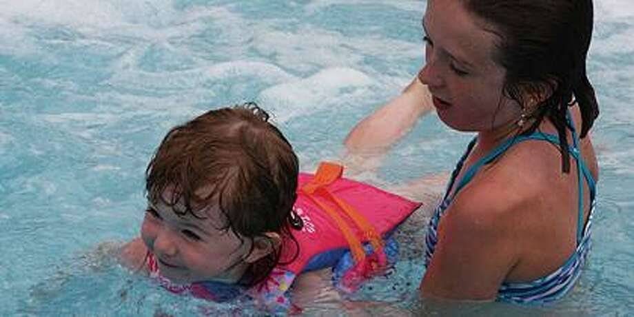 Claire Koth and Madalynne Toner enjoy the pool.