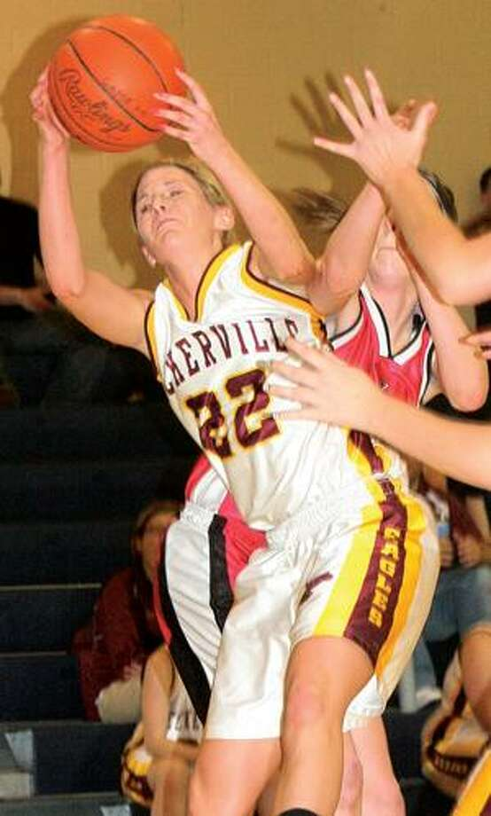 Deckerville's Tiffany Mausolf (22) pulls down a rebound during the second half of Kingston's 41-39 victory in the opening round of the Class D district on Monday night in Carsonville. For more sports photos, go to www.michigansthumb.com and click on the sports gallery.
