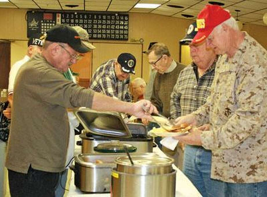 The Caseville Eagles sponsor a free breakfast for all area veterans. Eggs, sausage, toast, hash browns and beverages were served. Mike Dudzinski serves veterans Paul Partlow and Norm Olmstead at the end of the line.
