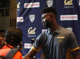 Jaylen Brown, right, speaks with students and teachers from the Deecolonize Academy after his press conference announcing his intention to go pro on Thursday, April 22, 2016 in Berkeley, Calif.