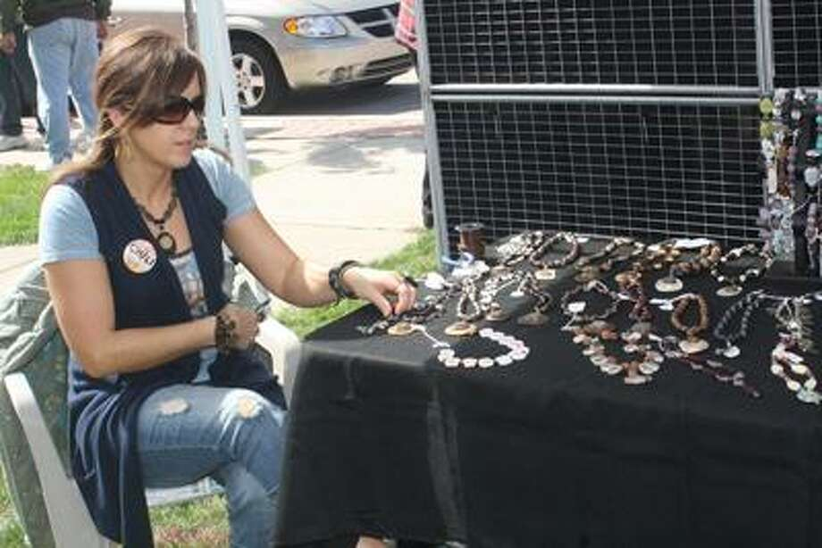 Jewelry maker Christy Doherty at Saturday's art show.