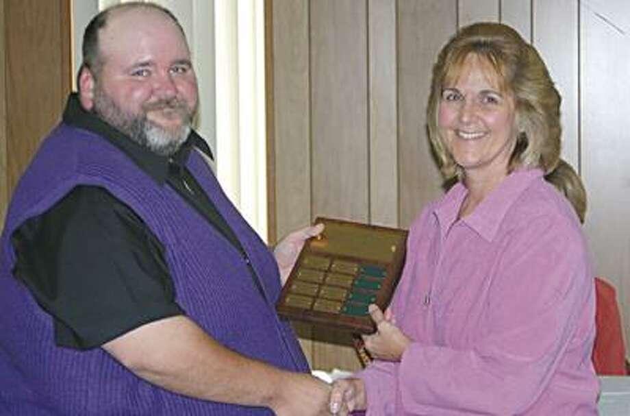 Travis Fischer receives an award.