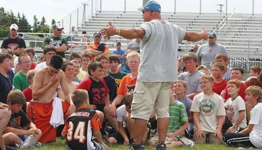 Cass City football coach Scott Cuthrell addresses campers on Wednesday at the Laker football field during the ninth annual Football Coaches' Camp for Kids.