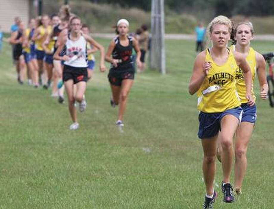 Bad Axe's Hailey Richards leads her teammate Crystal Schaible and a pack of runners on Tuesday during the Hatchet Early Bird Cross Country Meet. Richards won the meet by nearly three minutes.