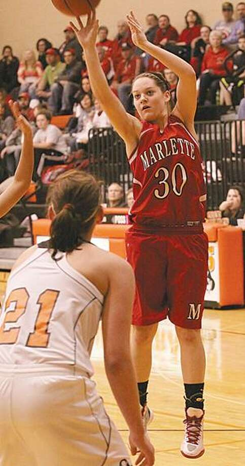 Marlette's Jenna Hirsch scored 13 points and had a team-high five assists as the Marlette varsity girls basketball team claimed the league title with a win at Harbor Beach. Photos by Marc Wilson.