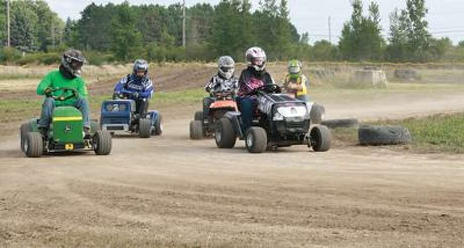 Lawn mower races were a big hit at this year's Autumn Fest, as riders zipped across the track at remarkable speed.