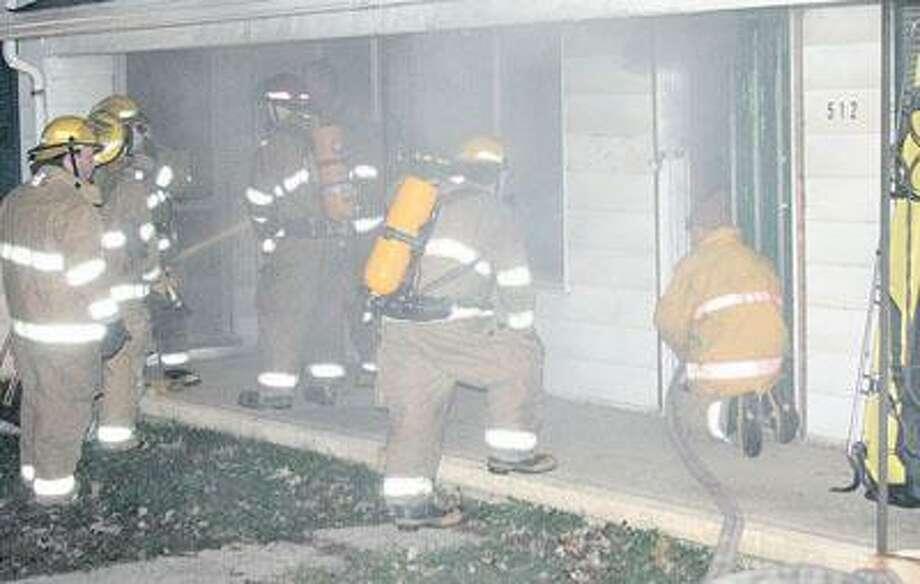Bad Axe Fire Department members begin training. Photo: Shawn Cartagena