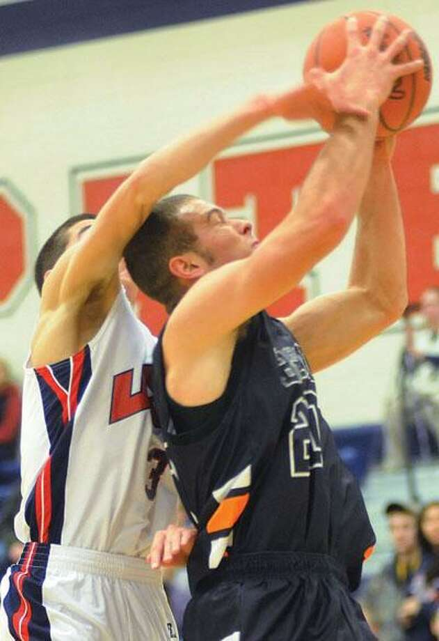 USA's Nick DeSimpelare (3) attempts to block the shot of Harbor Beach's Eli Kraft in the frist half.