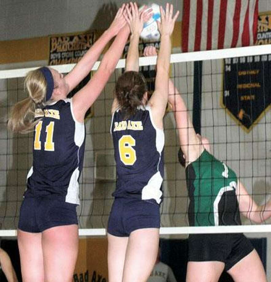 Bad Axe teammates Rachel Breault (11) and Natalie Breault (6) go for a block on EPBP's Breanna Richmond during a GTW volleyball match on Thursday in Bad Axe.For more sports photos, go to www.michigansthumb.com, staff photos and click on the sports gallery.