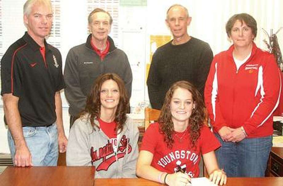 On Wednesday, November 14th, Marlette senior guard Jenna Hirsch signed a national letter of intent to play girls basketball at Youngstown State. Looking on are mom Shari Hirsch (seated) and back row left to right dad Brian Hirsch, AAU coaches Bob Sherlock and Marc Sroufe and MHS coach Cathy Storm.