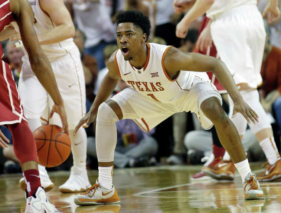 Texas' Isaiah Taylor plays defense against the Oklahoma Sooners at the Frank Erwin Center on February 27, 2016 in Austin, Texas. Taylor announced on Thursday that he has hired an agent and will enter the NBA Draft. He will not be able to return to Texas now for his senior season. Photo: Chris Covatta /Getty Images / 2016 Chris Covatta