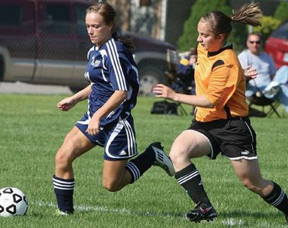 Bad Axe's Samantha Janik handles the ball against Harbor Beach's Kayla Zurek during the first half of the Pirates' 3-2 double overtime victory on Monday in Harbor Beach.