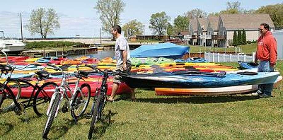 Chris Boyle and Terry Jimkoski get kayaks ready.