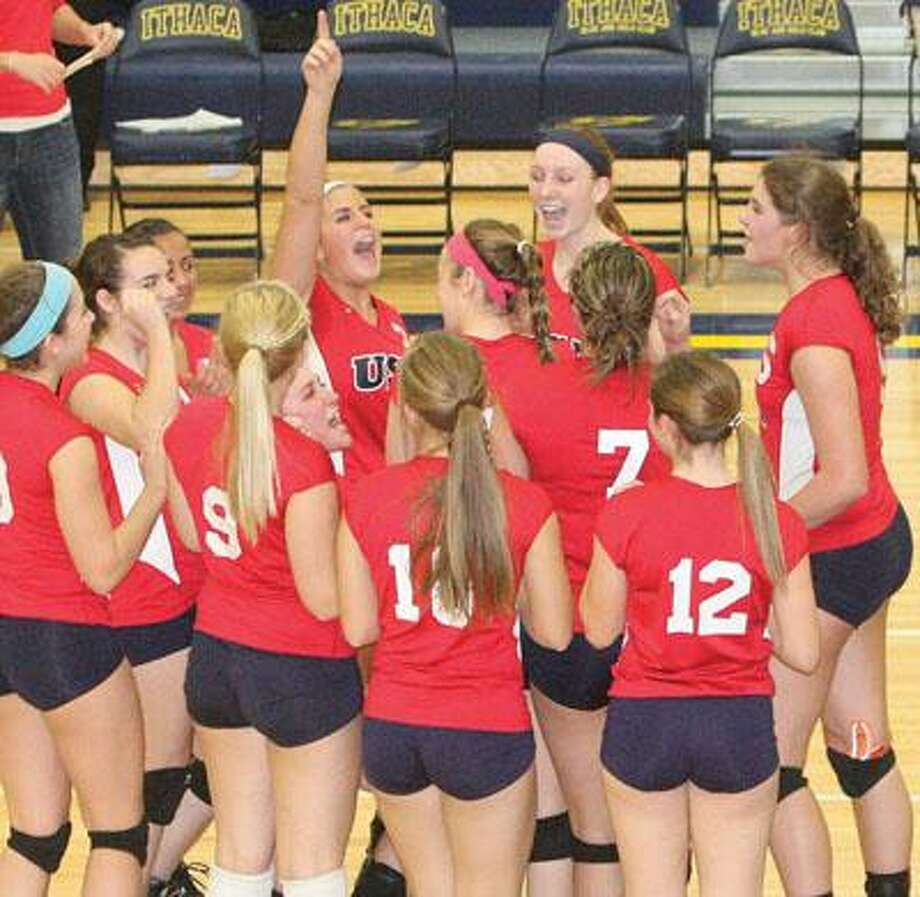 Ashlyn VanHoost (center) celebrates with her teammates after winning the match.For more sports photos, go to www.michigansthumb.com, staff photos and click on the sports gallery.