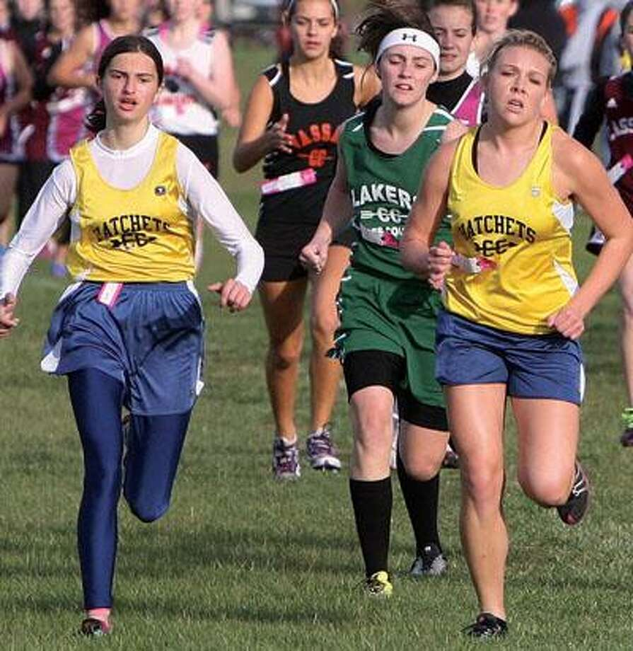 Bad Axe teammates Miranda Rzendzion (left) and Hailey Richards, along with EPBP's Sadie Muntz lead a group of runners near the start of the race on Tuesday in Bad Axe.For more sports photos, go to www.michigansthumb.com, staff photos and click on the sports gallery.