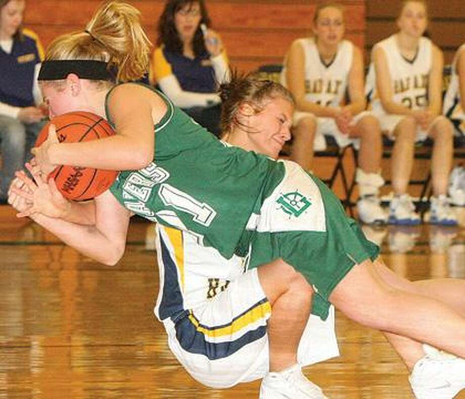 EPBP's Krissia Krohn (21) and Bad Axe's Shelby Fligger collide during the third quarter of the Lakers' 44-41 victory on Thursday night in Bad Axe.