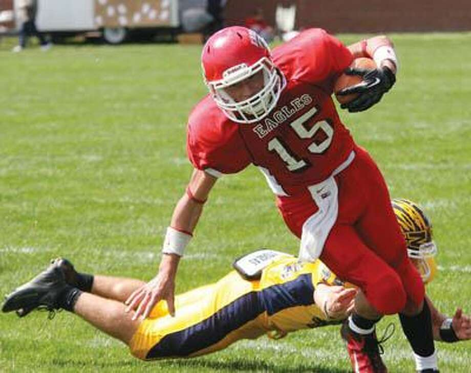 Caseville quarterback Tommy Kennedy (15) avoids the tackle of a North Huron player during the Eagles' home opener on Saturday.For more sports photos, go to www.michigansthumb.com, Staff photos and click on the sports gallery.