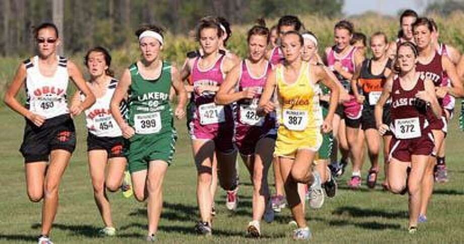 The pack is tightly bunched together at the start of the girls race on Wednesday at the EPBP Invitational.For more sports photos, go to www.michigansthumb.com, staff photos and click on the sports gallery.