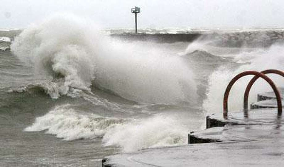 Waves crash along the PA breakwall. Photo: Unknown
