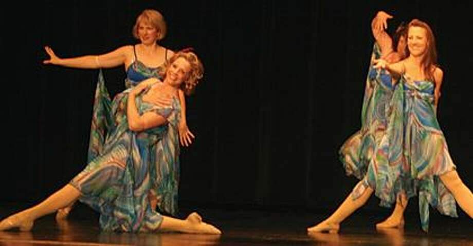 Adult dancers perform during a recital rehearsal.
